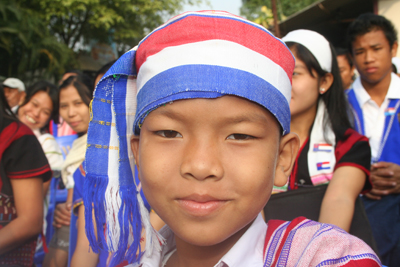 Nine year old Saw Zin Min proudly wore the colors of  the Karen flag during recent Karen New Year celebrations in Mae Sot.