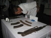 A man zooms for a closer look today (June 4, 2010) at a Rangoon police headquarters display of guns and ammunition used during an armed robbery on the night of May 16 in Dayellu Village in Kunchankone Township.