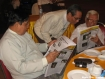 Takkatho Tin Kha (first left), Maung Wuntha (centre) and Paragu, run trained eyes over the People's Era Journal at its launch in Rangoon on Tuesday, July 6, 2010, at the M3 restaurant near the northern archway of Shwedagon Pagoda. Despite low demand and very tight censorship by the Press Scrutiny and Registration Division, publications are still entering the market ahead of this year's elections. Photo: Mizzima