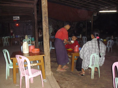 Toe Aung serving customers in his aunt's restaurant.