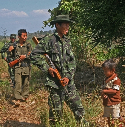 An ethnic rebel and his five-year-old son after fleeing attacks in their village in Burma. Photo: Steve Sanford/IRIN