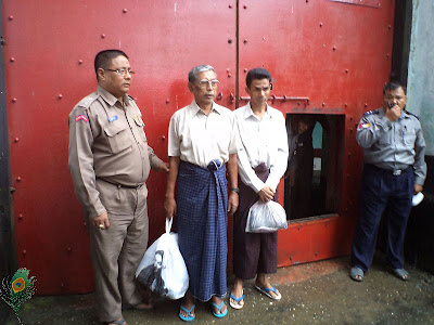 U Kyaw Hla Aung and U Win Naing were taken photo in front of Sittwe prison gate after releasing. (photo- Mizzima)