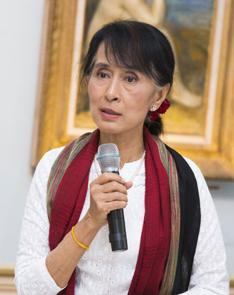 Aung San Suu Kyi, the chairperson of the Burmese National League for Democracy and a member of Parliament, speaks at a Women's Forum dinner in France on Friday, June 29, 2012. Photo: Women's Forum for the Economy and Society