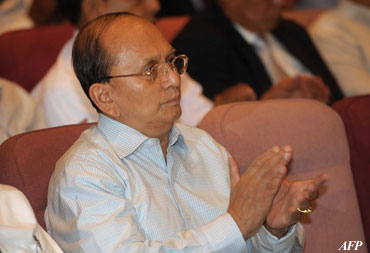 Burmese President Thein Sein applauds as he listens to a presentation during his visit to the Regional Investment and Economic Center at the Laem Chabang deep-sea port south of Bangkok during his three-day trip to Thailand, which ends on Tuesday. Photo: AFP