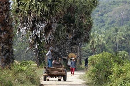 Farm workers drive down a road in a village in southern Myanmar near Dawei and the site of a planned special economic zone and deep sea port November 19, 2011.  Credit: Reuters/Staff/Files