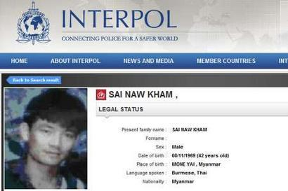 A screenshot from the Interpol website shows a picture of Naw Kham.