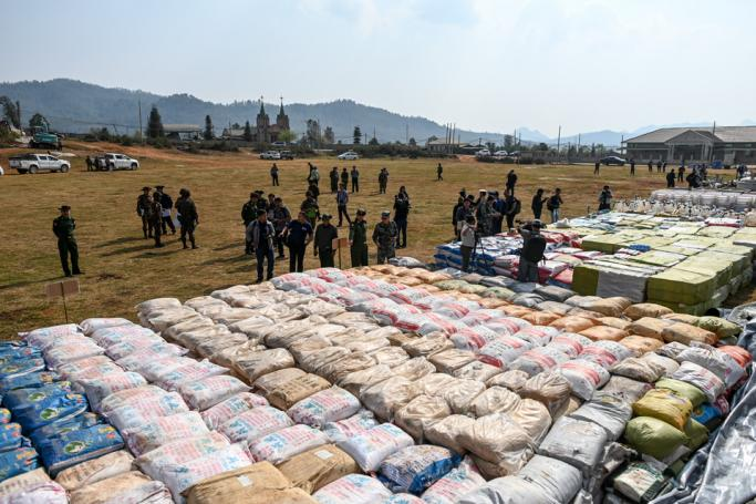 Foreign military attaches check drugs in a football ground where seized drugs vehicles laboratory accessories and precursor chemicals are being displayed to be witnessed by invited military attaches and journalists in Kawnghka at Shan State on Ma