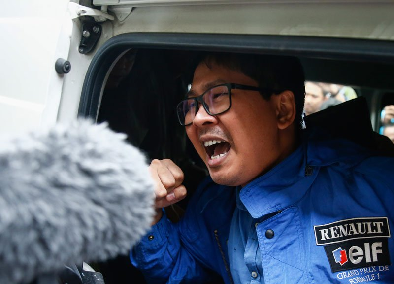Reuters&#039 journalist Wa Lone shouts as he leaves after his trial at Mingaladon township court in Yangon Myanmar 27 December 2017
